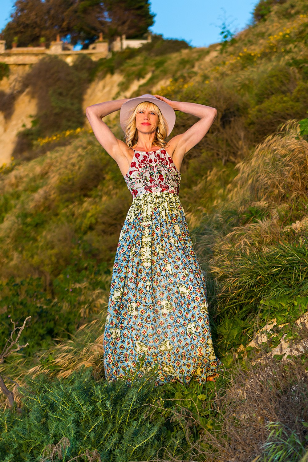 Lovely pose in Anthropologie dress and Michael Stars hat on hillside