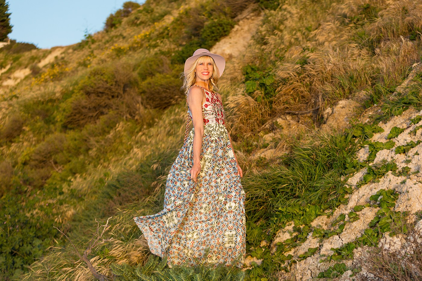 Anthropologie dress and Michael Stars hat on hillside at the beach