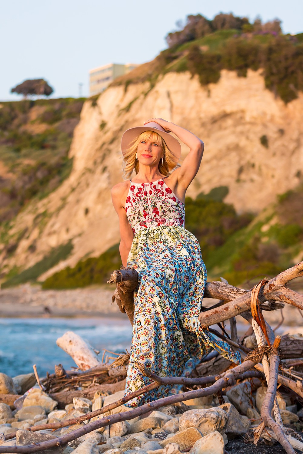 Anthropologie dress and Michael Stars hat on rocky beach